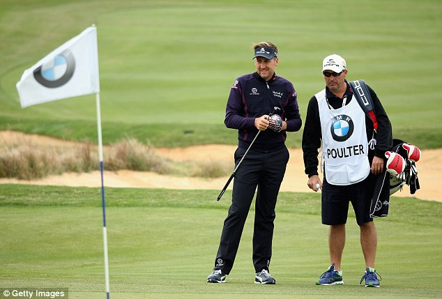 Working it out: Poulter chats with his caddy Terry Mundy in Shanghai