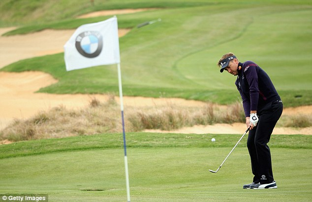 Chipping in: Poulter in action during the second round of the BMW Masters in Shanghai