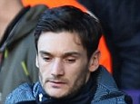 On the sidelines: Hugo Lloris (right) looks on from the stands after Andre Villas-Boas and his staff decided to leave him out of the Tottenham line-up to face Newcastle