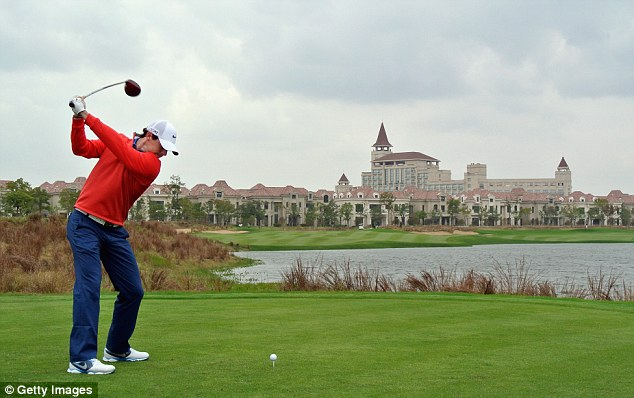 In the red: Rory McIlroy is within touching distance of the leaders at the BMW Masters in Shanghai