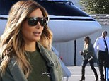 Living the high life: Kim Kardashian spends weekend eying potential new property with fiancé Kanye West before jetting out of town in private jet