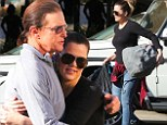 Still Daddy's girl! Khloe Kardashian gets a hug from stepfather Bruce Jenner as he joins the whole family, including estranged wife Kris, for charity yard sale