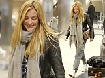 English television presenter, Cat Deeley looks stunning even though she's dressed down in sweats at LAX in Los Angeles. The sexy British star was seen wearing grey swets, but her hair looked perfect