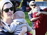 Feeling clucky? Anne Hathaway shows off her maternal side as she dotes on friend's baby during an outing to the park