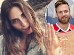 'She said yes!': Survivor star Aras Baskauskas drops to one knee during photo shoot and proposes to girlfriend