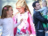 That's a bit cheeky! Jennifer Garner and Ben Affleck's girls playfully tease each other during a family day out