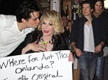 In need of a stiff drink! Orlando Bloom kisses new best friend Joan Rivers in Broadway... then heads to a liquor store