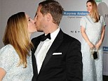 Pregnant Drew Barrymore kisses husband at Baby2Baby gala as she dresses her growing baby bump in a voluminous gown