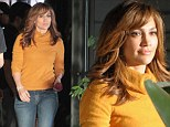 Dangerous curves! Jennifer Lopez shows off figure in form fitting yellow sweater while filming new thriller The Boy Next Door