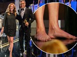 Julia Roberts goes barefoot while on stage with George Clooney at the Britannia Awards in Beverly Hills November 9