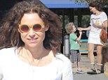 Minnie Driver dons summery white dress for breakfast outing with son Henry but ruins the look with furry winter boots