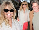 Still Overboard for each other! Goldie Hawn and Kurt Russell hold hands at LAX
