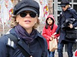 Brightening up the streets: Meg Ryan dressed down as her daughter wore a flashy red coat for a day out in New York's West Village on Sunday