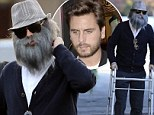 Reality star Scott Disick clowned around Sunday's Kardashian public garage sale by dressing as an old, graying man