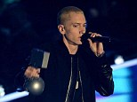 Triple cause to celebrate: Eminem landed his seventh consecutive number one UK album on Sunday night, as he picked up two prizes at the MTV EMA awards