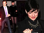 Catwoman's back! Anne Hathaway purrs in cheetah tights for an early 31st birthday dinner with husband Adam Shulman