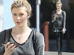 Keeping it VERY brief! Ireland Baldwin shows off long legs in micro mini skirt... but wears leggings to protect her modesty