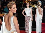 Jennifer Lawrence drowns her youthful figure in unflattering embellished 'Smarties' gown at The Hunger Games Catching Fire premiere