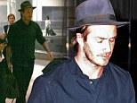 It's a hat trick! David Beckham cuts a dapper figure in matching dark blue trilby and shirt as he jets into Miami