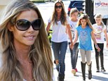 Denise Richards takes her mind off heartbreak over Charlie Sheen's twins by taking her daughters out for frozen yoghurt