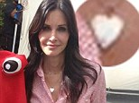 Has she found love again? Courtney Cox glows in pink shirt and silver heart necklace after David Arquette announces she has new boyfriend