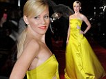 Bring me sunshine: Elizabeth Banks brings some colour to rainy The Hunger Games: Catching Fire premiere in yellow ballgown