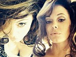 Big hair, don't care: Rose McGowan shared a snap of her voluminous 'do from a photo shoot on Sunday