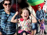 Superdad! Alexis Denisof wins giant stuffed watermelon slice as he and wife Alyson Hannigan treat daughters to a fun day out
