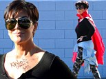 She'll do anything for attention! Kris Jenner mugs it up in a cape then writes across her chest in a bid to hog the limelight at family function