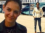 Sweet revenge? Katie Holmes stands in front of sign that reads 'Freedom' in South Africa as the veil over ex-husband Tom Cruise's peculiar personal life is lifted