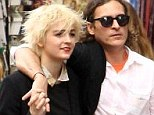 New flame: Joaquin Phoenix and his mystery woman cosy up to each other as they tourist around Rome where the actor is promoting his latest film Her
