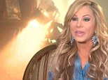 The moment of impact: Footage emerges of the moment Adrienne Maloof is caught in a deluge after an explosion sets off sprinklers during TV interview