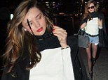 How to wear a coat Miranda Kerr style: Supermodel drapes her jacket over her shoulders and won't part with her tiny shorts at chilly Heathrow airport