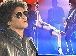 'King Of The Swingers': Bruno Mars performs racy rendition of hit song Gorilla alongside scantily-clad pole dancer at the MTV EMAs