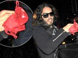Russell Brand gets a surprise gift following a performance in Dublin on Monday evening