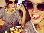 Forget the fasting! Alessandra tucks into a massive plate of steak and fatty fries just 72 HOURS before Victoria's Secret show