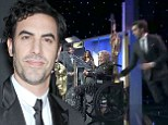 Sacha Baron Cohen shocks audience as he knocks elderly woman off stage after accepting Charlie Chaplin award