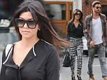 Black and white: Kourtney Kardashian flashed a little flesh in a black blouse on Tuesday while shopping in New York City