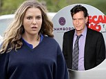 Why so grumpy? Brooke Mueller looks glum on day it emerges Charlie Sheen will not face contempt of court hearing