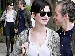 The look of love! Anne Hathaway's husband Adam Shulman gazes adoringly at her as they celebrate her 31st birthday