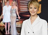 Jennifer Lawrence does winter chic in pleated white coat as Elizabeth Banks steals the show in metallic beaded gown