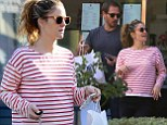 Eating for two: Drew Barrymore shows off her blossoming baby bump in striped top as she satisfies cravings on lunch outing
