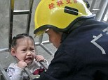 Chyou Wang fell through the window grill but was saved from falling when her head became stuck