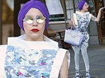Will tumble for food! Lady Gaga looks dazed and confused in blowfly sunglasses and metal capped shoes