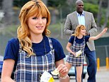 Bella Thorne wears playful dungarees as she larks around with Shaquille O'Neal while shooting underage drinking campaign