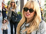'I'm 9 months pregnant!': Rachel Zoe claims she's 'going into hibernation' as she prepares for her second child, but first takes her son Skyler shopping at Tom's Toys in Beverly Hills, California on Monday