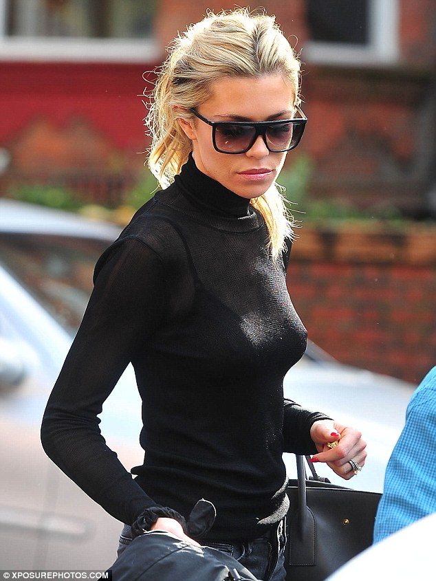 Where's the sun? The Strictly contestant tied her hair up in a ponytail while wearing large, dark sunglasses