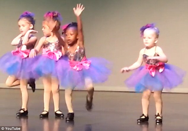 Moves of her own: A little girl, identified as Jordyn, makes sure she's centre stage at her tap recital