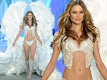 How can you walk in those? Angel Behati Prinsloo takes to the Victoria's Secret Fashion Show catwalk in pair of giant wings