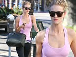 Victoria's Secret angel Rosie Huntington-Whiteley catwalks to the gym in tight leggings but is left out of the fashion show